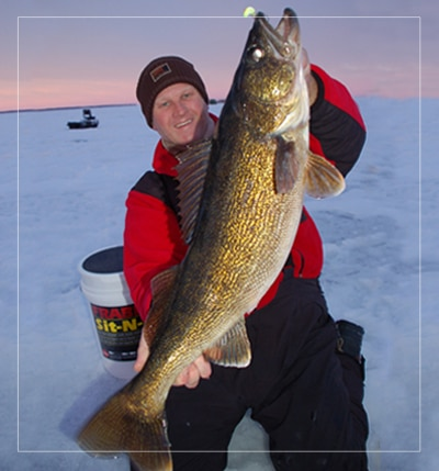 ice fishing guide bret alexander with huge walleye