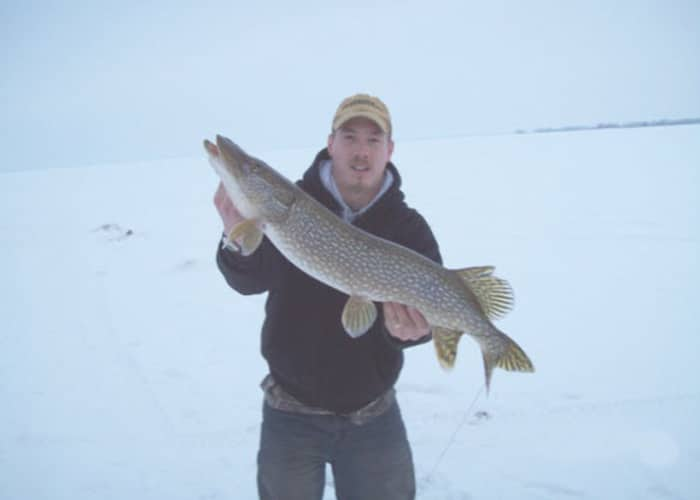 ice fishing for pike in sturgeon bay