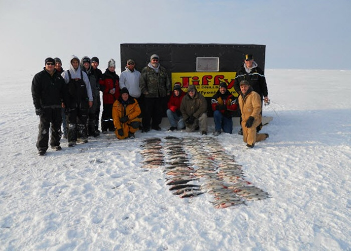 group ice fishing with guide sturgeon bay